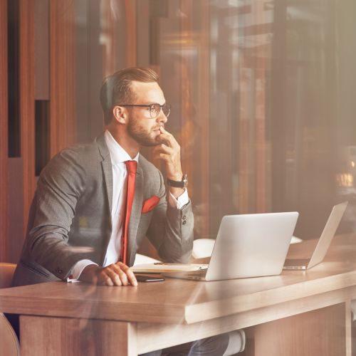 confident-professional-businessman-using-his-lapto-9TLXZ4S-min (1)
