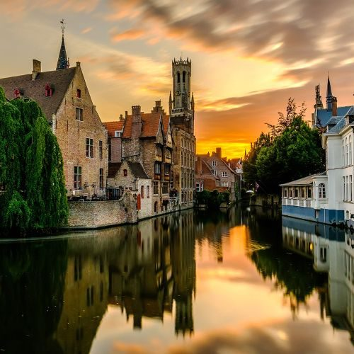 bruges-brugge-cityscape-with-water-canal-at-sunset-P878L6Q-min