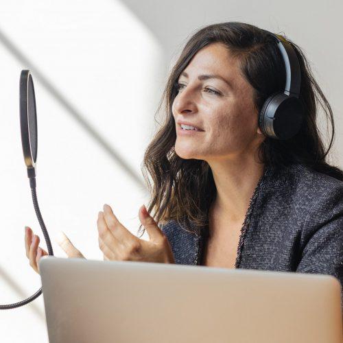 businesswoman-interviewed-for-a-podcast-Q5GG85Z-min
